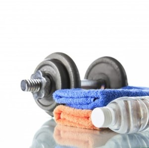 Dumbbell With Water And Towel -  Image courtesy of Naypong / FreeDigitalPhotos.net